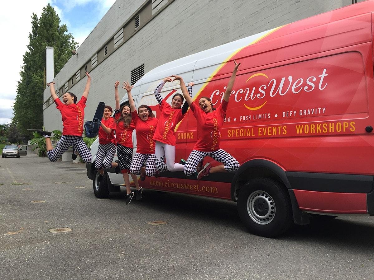 Jumping Kids in front of van